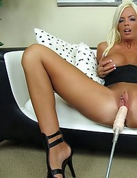 Horny cougar Jordan Blue pleasures her pink pussy with an electronic dildo