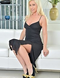 Horny housewife teases in her sexy black dress