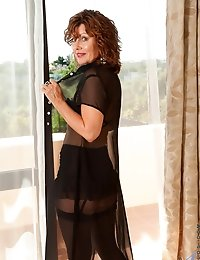 Anilos Cascade shows off her cougar frame in alluring lingerie