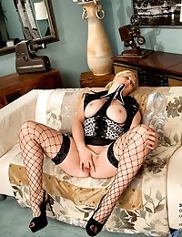 Big breasted mom in heels and stockings masturbates on sofa