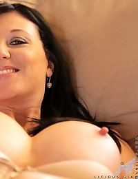 Gorgeous mom with big boobs stuffs her pussy with a dildo