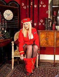 Naughty stewardess reveals sexy legs in stockings and fine ass