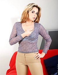 Anilos temptress Anuska shows off her massive milf breasts and her sexy frame in tight pants