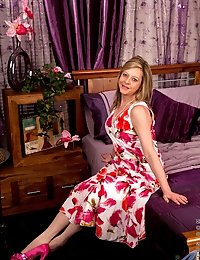 Sweet Anilos milf in her floral dress reveals her hot bra and pink panties