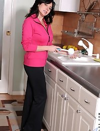 Naughty Karen Kougar strips off her office attire and exposes her underwear set in the kitchen