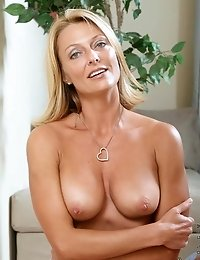 Naughty blonde milf massages her perky tits and spreads her pink pussy