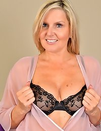 Hot and horny mommy can't wait to strip down and play
