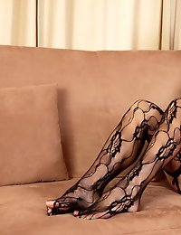 Sultry blonde cougar wears sexy lingerie and thigh highs