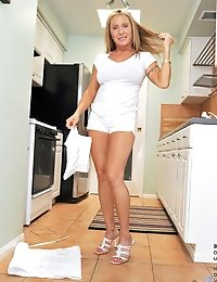Anilos Luna is a sexy chef who enjoys baking in her sexy all white dress and high heels looking so yummy