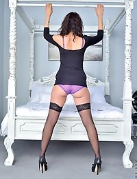 Seductive cougar wears mouthwatering purple lingerie