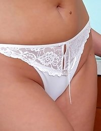 Anilos pandora is a vision of beauty with her mature breasts almost spilling out of her white lace bra