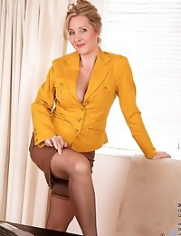 Horny Anilos milf executive looks great as she pleasures her hairy pussy in the office