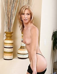 Enticing Anilos cougar Dee Dee flaunts her perfect ass in a sexy barely there thong